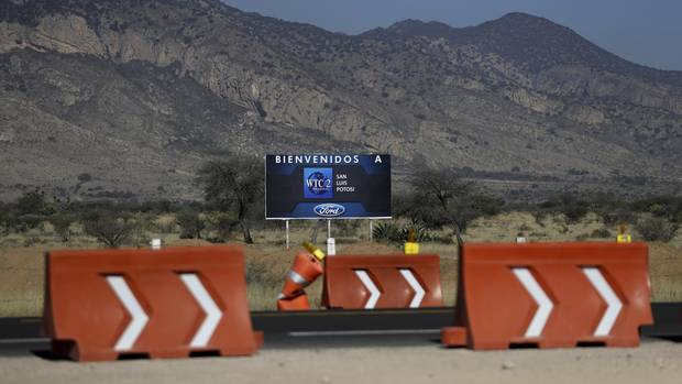 A welcome sign stands at the site where Ford's suppliers and service providers were to have been housed, one day after Ford cancelled plans to build the plant in Villa de Reyes, outside San Luis Potosi, Mexico, Wednesday, Jan. 4, 2017.