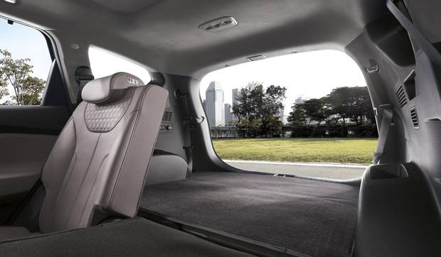 The rear seats can be moved forward for a little extra room.