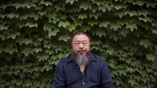 Chinese artist Ai Weiwei poses for a portrait at his studio in Beijing, China on May. 22, 2012.