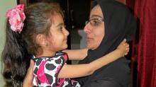 Shoreh Pirani, widow of the slain Iranian electrical engineer Darioush Rezaeinejad, holds her daughter Armita.