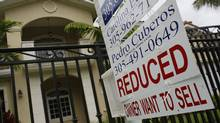 A for sale sign stands in front of a home in Miami, Florida. (Joe Raedle/Getty Images)