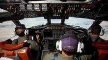 Co-Pilot Flying Officer Marc Smith and crewmen fly at high altitude aboard a Royal Australian Air Force (RAAF) AP-3C Orion aircraft after searching for the missing Malaysian Airlines Flight MH370 over the southern Indian Ocean March 24, 2014. An Australian aircraft scouring the southern Indian Ocean for signs of a Malaysia Airlines jet missing for more than two weeks has spotted two new objects, Australian Prime Minister Tony Abbott said on Monday. Abbott told parliament an Australian naval vessel was near where the objects, one circular and greenish grey in colour and the second orange and rectangular, had been seen and hoped to be able to recover them soon. Picture taken March 24, 2014. (Richard Wainwright/REUTERS)