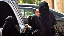 Saudi women exit a car in Riyadh on September 26, 2011 a day after King Abdullah granted women the right to vote and run in municipal elections, in a historic first for the ultra-conservative country where women are subjected to many restrictions. (FAYEZ NURELDINE/AFP/Getty Images)