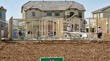 Workers frame a new home in a KB Home development (Matt York/Matt York/AP)