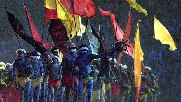 Sydney, 2000: Aboriginal dancers carry flags during the opening ceremony of Sydney's Olympic Games. (PETER MUELLER/Reuters)