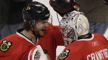 Chicago Blackhawks goalie Corey Crawford, right, celebrates with Michael Frolik after they defeated the Vancouver Canucks 4-3 in Game 6 of an NHL hockey Stanley Cup playoffs first-round series Sunday, April 24, 2011, in Chicago. (AP Photo/Nam Y. Huh) (Nam Y. Huh)