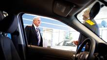 Dom Romeo, CEO of Pine View Pontiac Buick GMC Trucks, speaks with an employee in the showroom. (Anne-Marie Jackson/Anne-Marie Jackson/THE GLOBE AND)
