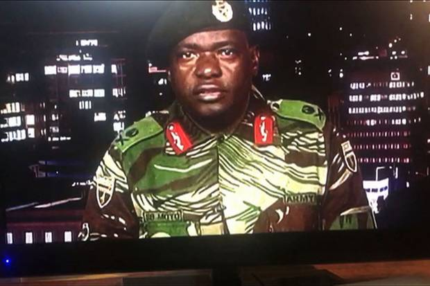 Nov. 15: Major-General Sibusiso Moyo reading a statement on television announcing the military takeover.