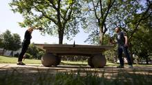 Two table tennis players with SPiN Toronto, community manager Lindsey Fletcher, left and director of marketing Shawn Topp, test out a table at Stanley Park on Thursday. (Deborah Baic/The Globe and Mail)