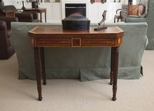 The mahogany card table in the library is a superb example of craftsmanship by John Tulles of Halifax.