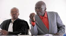 Leon Mugesera, right, and his Rwandan attorney, Donat Mutunzi, in court in Kigali, Rwanda, on April 2, 2012. (Steve Terrill/Steve Terrill)
