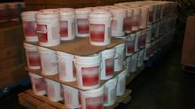 Containers seized by the Canada Border Services Agency, which claimed to contain soy sauce but actually contained precursor chemical Hypophosphorous Acid. (Photo courtesy of the CBSA)
