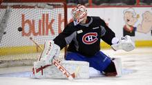 Montreal Canadiens' Carey Price deflects a shot during practice at the Scotiabank Place in Ottawa on Monday, May 6, 2013. (Sean Kilpatrick/THE CANADIAN PRESS)