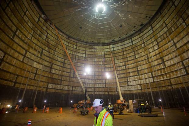 Construction workers stand inside a liquefied natural gas storage tank under construction at FortisBC's Tilbury LNG facility as part of their $400-million expansion, during a media tour in Delta, B.C., on Monday November 16, 2015.