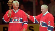 Montreal Canadiens greats Jean Béliveau, left, and Maurice (Rocket) Richard exchange a torch during closing ceremonies after the final game at the Montreal Forum, Monday, March 11, 1996. (RYAN REMIORZ/The Canadian Press)