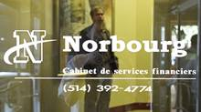 A plainclothes police officer guards the offices of Norbourg Asset Management Inc. in Montreal in this 2005 file photo. (Paul Chiasson/CP PHOTO/Paul Chiasson)