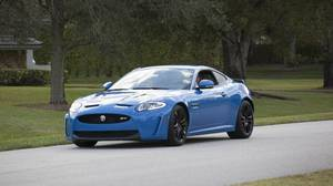 Nicko McBrain, the drummer of the British heavy metal band Iron Maiden, in his 2013 Jaguar XKR-S