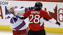 New York Rangers' Sean Avery (L) fights Ottawa Senators' Zenon Konopka minutes into the first period of their NHL hockey game in Ottawa November 9, 2011. (BLAIR GABLE/REUTERS)