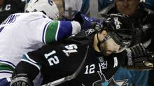 San Jose Sharks center Patrick Marleau (12) collides with Vancouver Canucks left wing Alex Burrows (14) during the second period in Game 3 of the NHL hockey Stanley Cup Western Conference final playoff series in San Jose, Calif., Friday, May 20, 2011. (AP Photo/Marcio Jose Sanchez) (Marcio Jose Sanchez/AP)