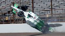 Simona De Silvestro of Switzerland crashes in the third turn during practice for the Indianapolis 500 on May 19, 2011. She suffered second-degree burns to her right hand and less serious ones to her left. (Mark Miller/Mark Miller/AP Photo)
