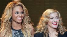 "Beyonce and Madonna at the taping of ""Oprah's Surprise Spectacular"" in Chicago, May 17, 2011. (John Gress / Reuters)"