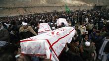 Shi'ite Muslims carry coffins of victims killed in Saturday's bomb attack, during a funeral in Quetta February 20, 2013. Pakistani Shi'ites agreed to bury those killed in the most recent sectarian bombing, ending four days of protests, after the government said on Tuesday it had arrested 170 suspects linked to the attack. (NASEER AHMED/REUTERS)