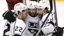 Los Angeles Kings' Trevor Lewis (22), Drew Doughty (8), and Jarret Stoll (28) celebrate a goal by Dwight King against the Phoenix Coyotes in the first period during Game 2 of the NHL hockey Stanley Cup Western Conference finals, Tuesday, May 15, 2012, in Glendale, Ariz. (Ross D. Franklin/AP/Ross D. Franklin/AP)