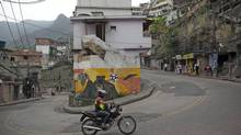Several of the steep roads winding upward in Rocinha have now been paved, a sign of the neighbourhood's steady rise. (Nadia Sussman for The Globe and Mail)