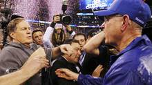 New England Patriots head coach Bill Belichick speaks with New York Giants head coach Tom Coughlin after the Giants won the NFL Super Bowl XLVI football game in Indianapolis. (MIKE SEGAR/Reuters)