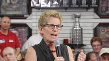 Liberal Leader Kathleen Wynne speaks to supporters at a campaign event at a sports memorabilia store and cafe in Niagara Falls, Ont., on June 7. (COLIN PERKEL/THE CANADIAN PRESS)