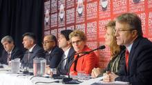 Ontario Liberal party leadership candidates (left to right) Glen Murray, Charles Sousa, Harinder Takhar, Eric Hoskins, Kathleen Wynne, Sandra Pupatello and Gerard Kennedy take part in a debate in Thunder Bay, Ont., Sunday, Dec. 9, 2012. (Brent Linton/THE CANADIAN PRESS)