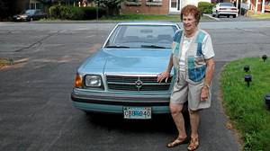 Marjorie Beare and her beloved blue K-car.