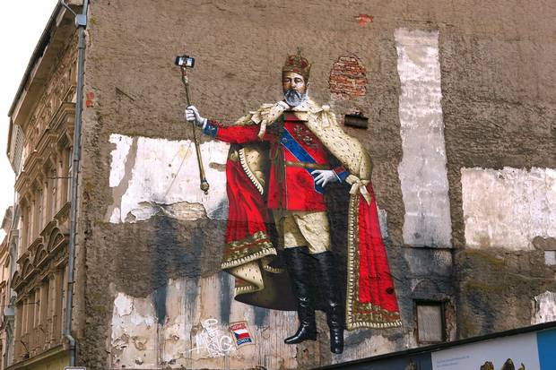 Olomouc is best known for its Baroque architecture, but street art like this mural of a king holding a selfie-stick in place of a scepter, prove this Czech university city doesn't take itself too seriously.