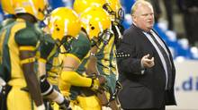Mayor Rob Ford coaches the Don Bosco Eagles football team during the Metro Bowl at the Rogers Centre in Toronto, Nov. 27, 2012. (Kevin Van Paassen/The Globe and Mail)