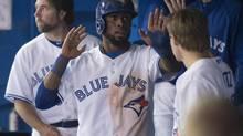 Toronto Blue Jays' Jose Reyes celebrates with teammates (Darren Calabrese/THE CANADIAN PRESS)