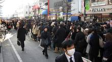 "Commuters queue for a train at the Akihabara JR station in downtown Tokyo as only minimal service is maintained, on March 14, 2011. With ports, airports, highways and manufacturing plants shut down after the March 11 monster earthquake, the Japanese government predicted ""considerable impact on a wide range of our country's economic activities"". (Jiji Press/AFP/Getty Images/Jiji Press/AFP/Getty Images)"