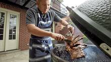 Perfect ribs need smoke, but you don?t need a smoker. A charcoal grill and wood chips will do the trick. (Jennifer Robers for The Globe and Mail)