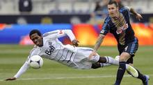 Philadelphia Union's Danny Califf, right, collides with Vancouver Whitecaps' Atiba Harris (Michael Perez/AP)