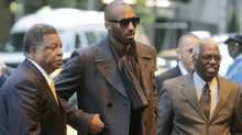Los Angeles Lakers' Kobe Bryant, centre, arrives for a meeting in New York, Monday. (Seth Wenig/Assocaited Press)
