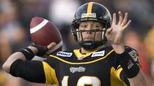 Hamilton Tiger-Cats quarterback Quinton Porter throws the Tiger-Cats' first touchdown of the game to Prechae Rodriguez during a CFL game against the B.C. Lions in Hamilton, Ont., on Friday, July 31, 2009. (Darren Calabrese)