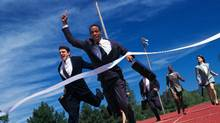 Businessmen run a competitive race. You need an entrepreneurial spirit to be competitive in business today. (Photos.com)