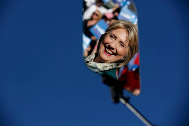 Hillary Clinton is reflected in a glass teleprompter as she holds a rally with grassroots supporters in Alexandria, Virginia, last October.