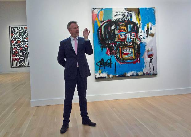 A Sotheby's official speaks about an untitled painting by Jean-Michel Basquiat during a media preview on May 5 in New York.