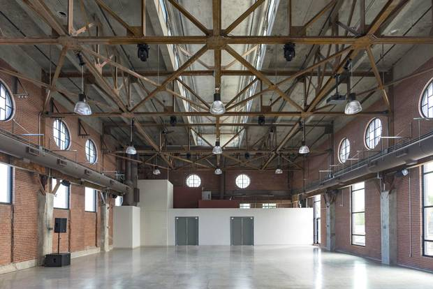 The Symes spent 'a gazillion dollars' restoring the space, highlighting original features such as the concrete columns and steel beams along the ceiling.