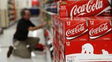 An employee arranges bottles of Coca-Cola at a store in Alexandria, Virginia October 16, 2012. (KEVIN LAMARQUE/REUTERS)