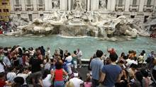 In this file photo, tourists gather in front of the Trevi fountain in Rome. (Alessandra Tarantino/AP)