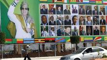A huge picture of Libyan leader Moammar Gadhafi and other African leaders adorns a street in the Libyan city of Sirte. (KHALED DESOUKI/KHALED DESOUKI/AFP/Getty Images)