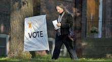 A woman makes her way to a Toronto polling station as voters cast their ballots in the Ontario election on Oct. 6, 2011. (Chris Young/THE CANADIAN PRESS)