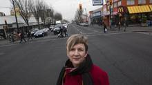 Patricia Barnes, head of the Hastings North Business Improvement Association, at the intersection of East Hastings Street and Penticton Street in Vancouver's East Village. (Deborah Baic/The Globe and Mail)