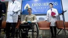 U.S. Army Sgt. Brendan Marrocco of Staten Island, New York, who lost his four limbs in a 2009 roadside bomb attack in Iraq, is pictured during a news conference after receiving double arm transplants, performed by a Hopkins medical team at The Johns Hopkins Hospital, in Baltimore, Maryland January 29, 2013. With him are Johns Hopkins School of Medicine's Department of Plastic and Reconstructive Surgery Director W.P. Andrew Lee (R) and Johns Hopkins Medicine's Vascularized Composite Allotransplantation Program Scientific Director Gerald Brandacher. (JOSE LUIS MAGANA/REUTERS)